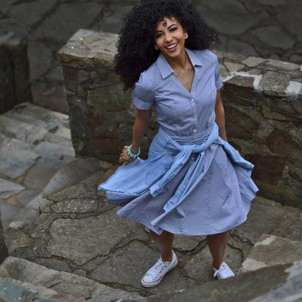 mixed girl happy twirl in casual versatile blue shirt dress for work