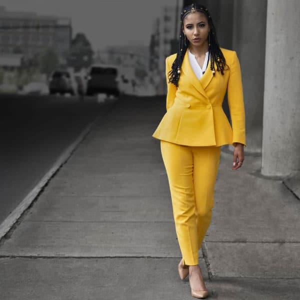 Is Natural Hair Unprofessional? Five Reasons to Wear Natural Hair to Work in yellow suit with braids