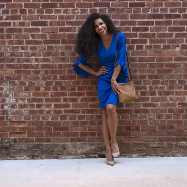after work tailgate outfit cobalt blue business casual dress brick wall